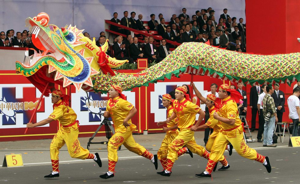 Dragon dance performers participate in the national day celebrations of the centenial anniversary of the founding of the Republic of China government in Taipei, Taiwan, Monday, Oct. 10, 2011. National Day is known as Double-Ten Day, Oct. 10, commemorating the Chinese republican revolution of October 10, 1911, bringing the end of mainland China's Qing dynasty. (AP Photo/Chiang Ying-ying)